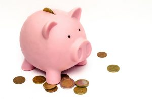 piggy bank used to pay for holiday home taxes and regulations